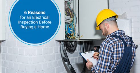 Professional electrician inspecting a home
