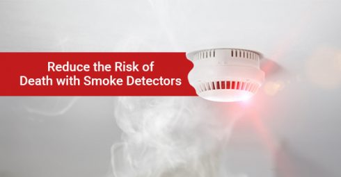 Smoke detector mounted on roof in apartment
